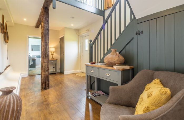 Ground floor: The spacious entrance hallway with wooden floors and beams