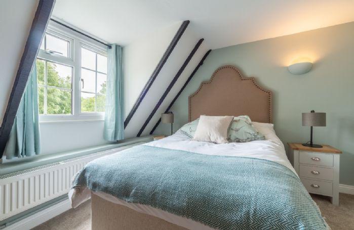 First floor: Double bedroom and original beams