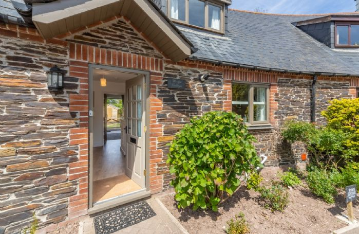 Wedge Cottage is a stunning holiday home located in the Curved Stables at Roserrow