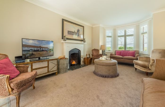 Ground floor: Large sitting room with a wood burning stove and comfortable seating