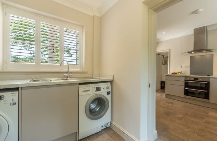 Ground floor: Utility room with washing machine and tumble dryer
