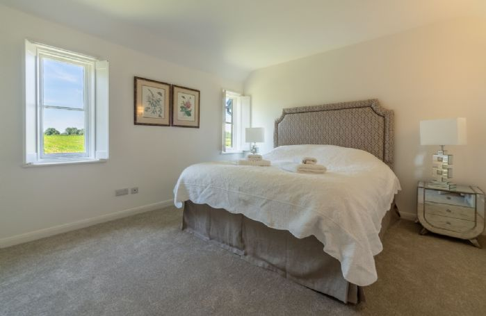 First floor: Spacious bedroom with 6' king size bed and en-suite shower room