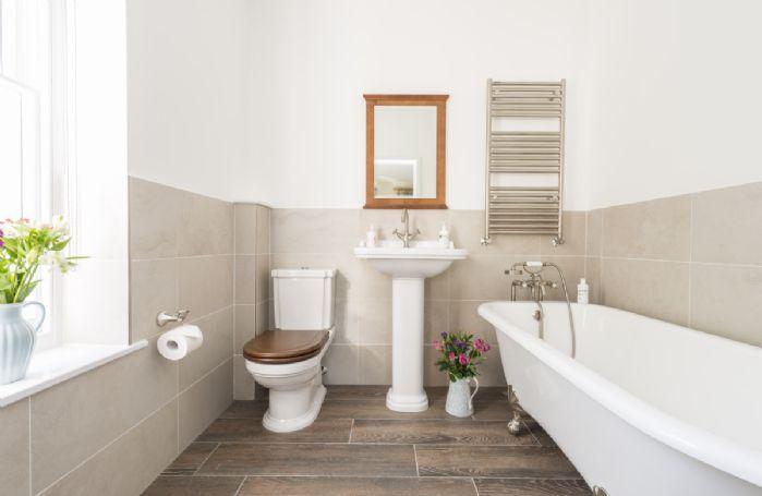 First floor:  En-suite bathroom with roll top bath