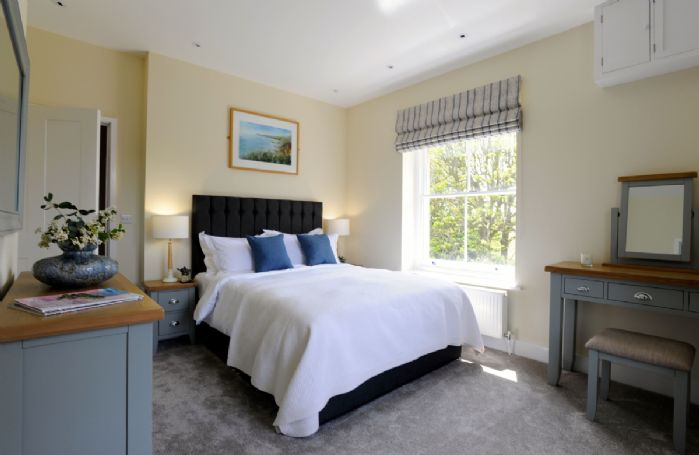 First floor:  Bedroom with a king size bed