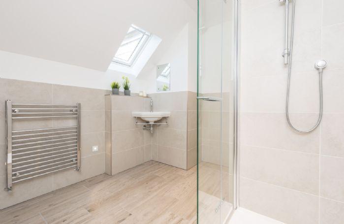 Second floor:  En-suite shower room with large, walk in shower