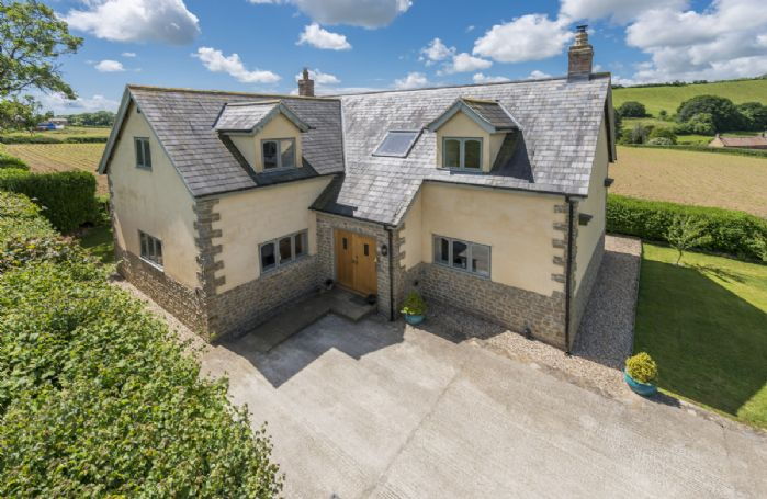 Aerial view of Hideaway Cottage and beautiful surrounding countryside