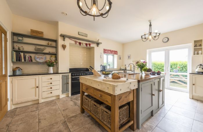 Ground floor: Fully equipped kitchen with french doors leading out to the garden
