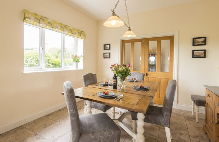 Ground floor: Dining room with table seating up to eight guests