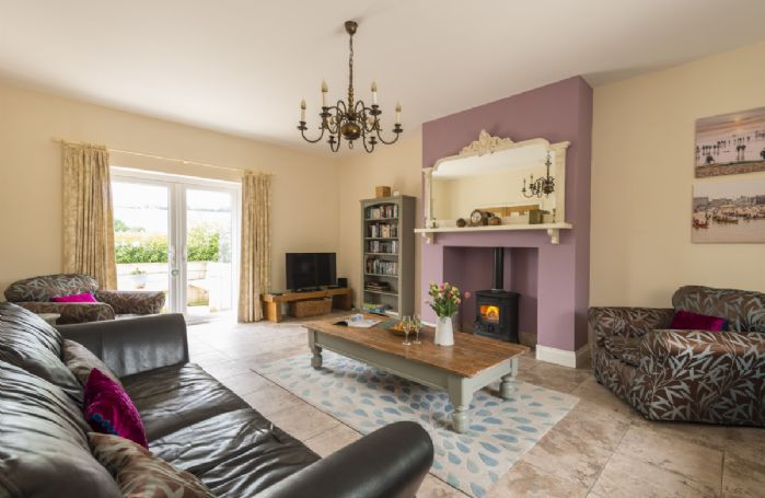Ground floor: Sitting room with wood burning stove and french doors leading out to garden