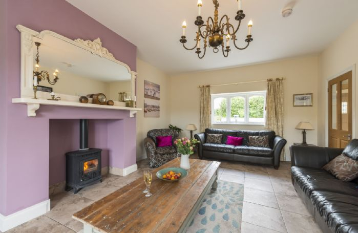 Ground floor: The spacious sitting room with comfortable sofas and tiled flooring