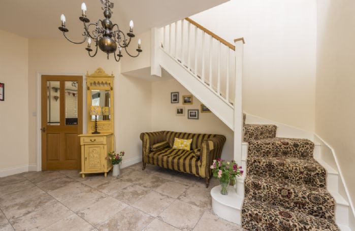 Ground floor: The spacious hallway with stairway leading to upstairs