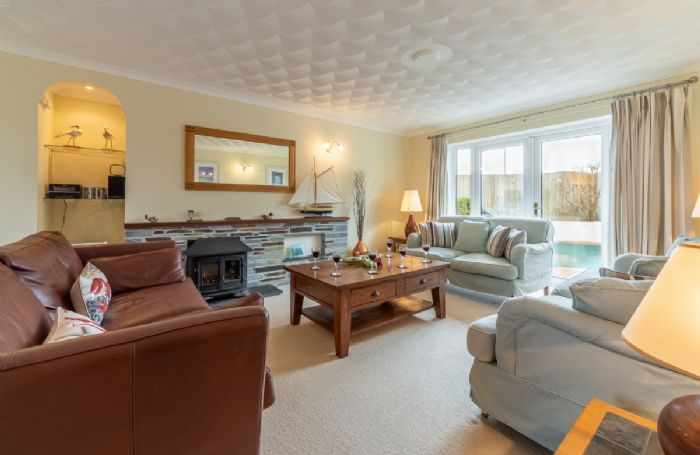 Ground floor:  Spacious sitting room with french doors to pool terrace