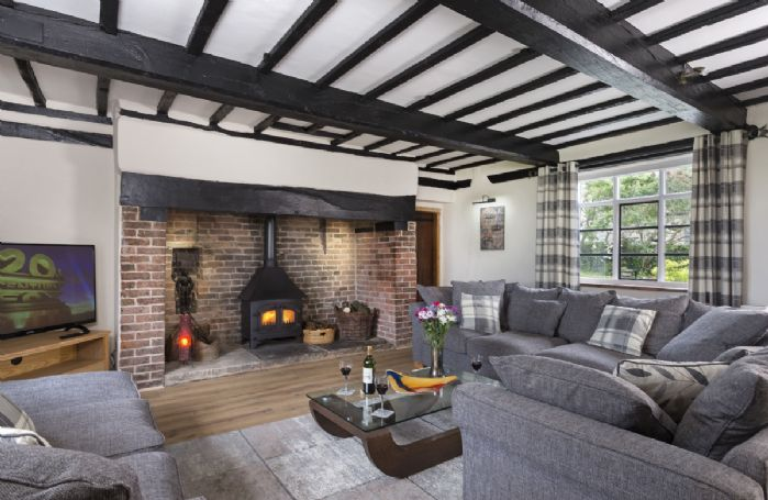 Ground floor: Spacious sitting room with inglenook fireplace and wood burning stove