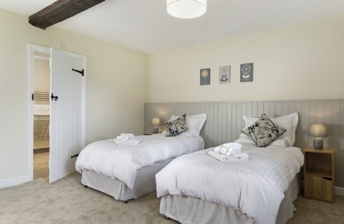 Ground floor: Bedroom with 6' super king size zip and link beds with en-suite shower