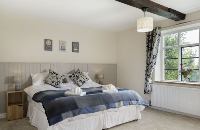 Ground floor: Bedroom with 6' super king size zip and link beds (configured as a super king) and en-suite shower
