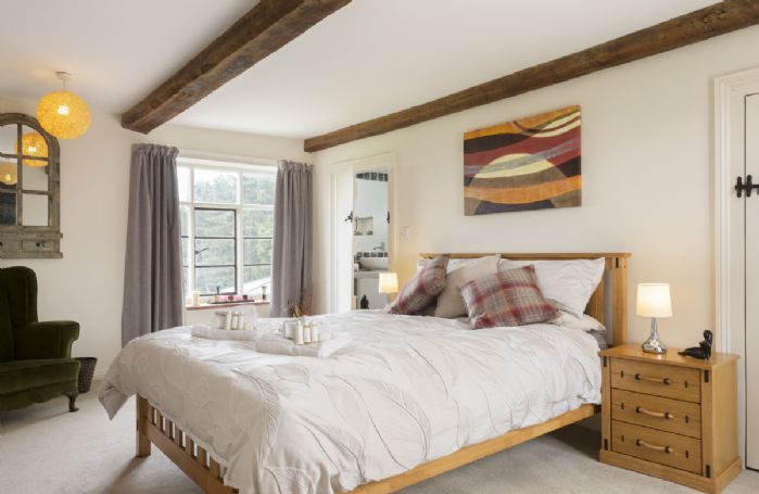 First floor: Bedroom with 5' king size zip and link beds and en-suite shower room