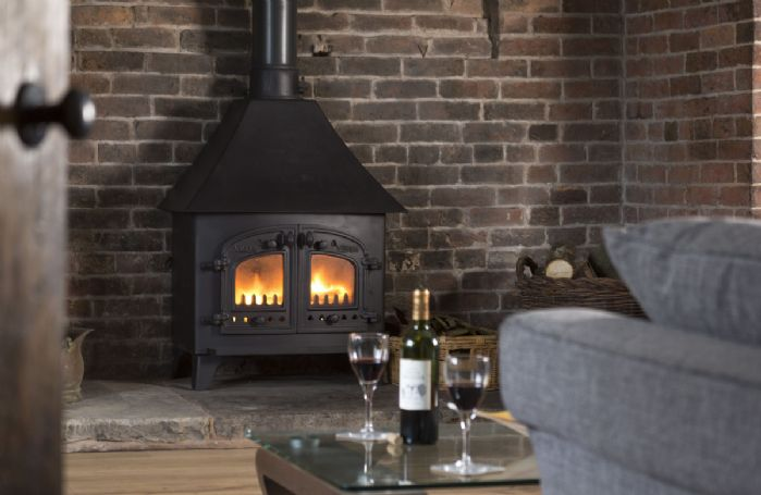 Ground floor: Wood burning stove in the comfortable sitting room