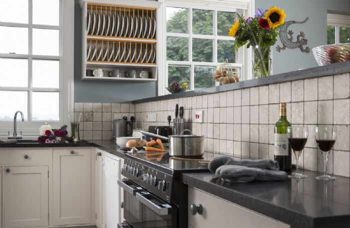 Ground floor: Fully equipped kitchen with electric range cooker