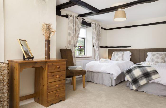 First floor: Bedroom with 6' king size zip and link bed and en-suite bathroom