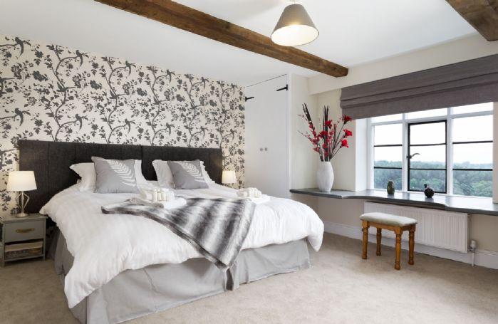 First floor: Bedroom with 6' super king zip and link bed and en-suite shower room