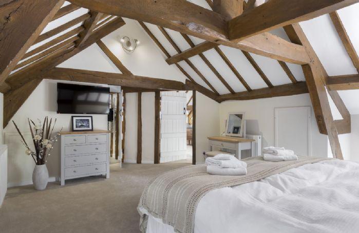 Second floor: Bedroom with 6' super king zip and link bed and en-suite bathroom