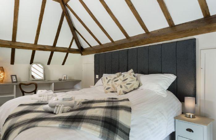 Second floor: Bedroom with 6' super king zip and link bed and en-suite shower