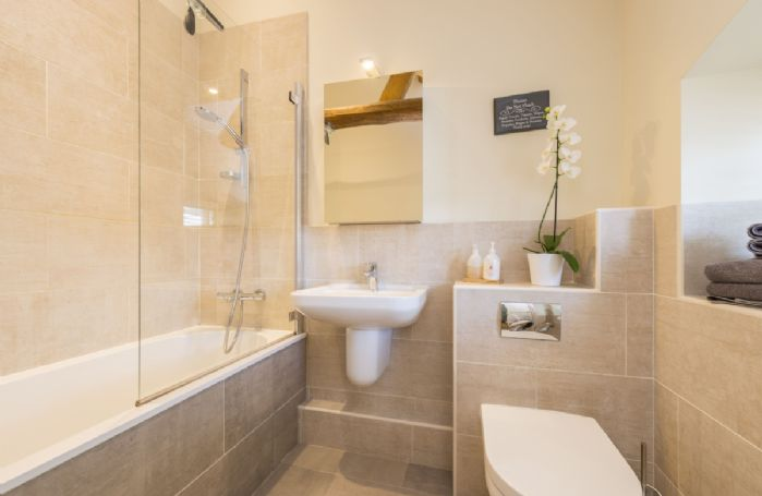 Ground floor:  En-suite bathroom with shower over