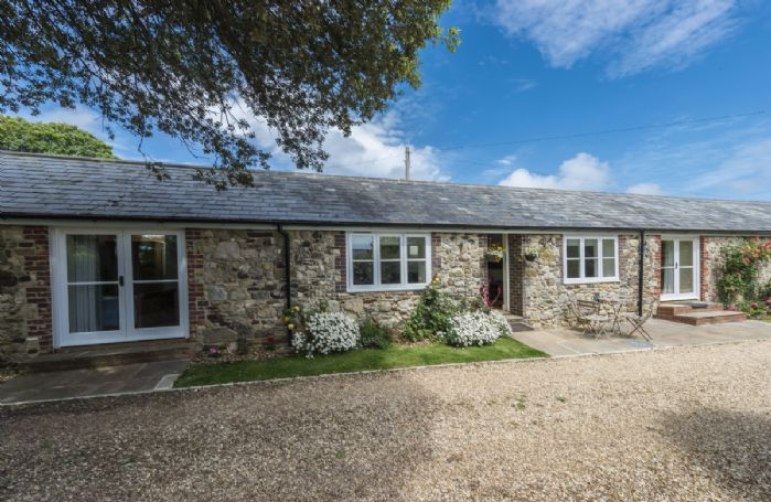 Dapple Cottage has a south-facing patio, ideal for al fresco dining