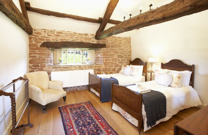 First floor: Twin bedroom with 3' beds and original oak beams