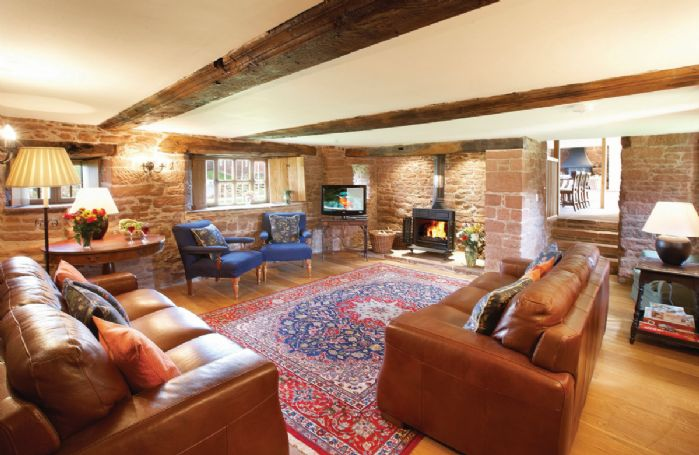 Ground floor: Spacious sitting room with wood burning cast iron stove