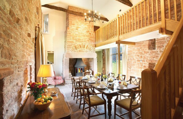 Ground floor: Stone flagged and galleried dining room with massive stone fireplace