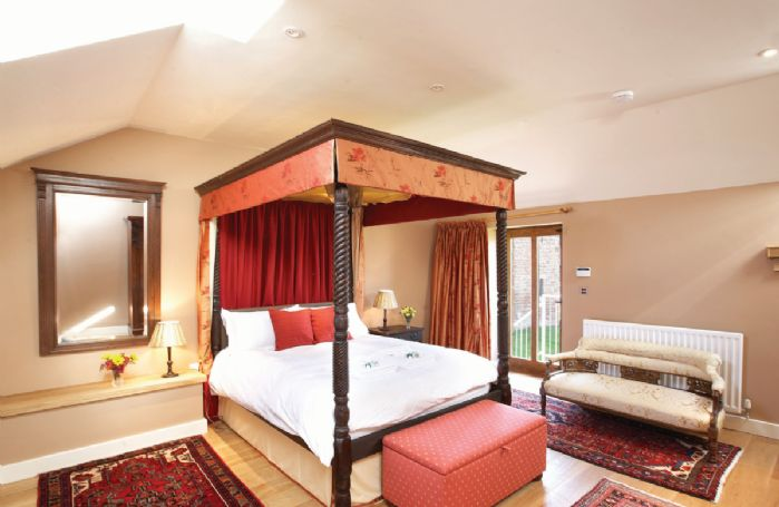 First floor: Master bedroom with 5' four poster bed and en-suite bathroom and separate shower