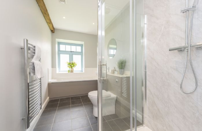 Ground floor:  Family bathroom with separate shower