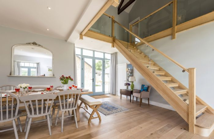 Ground floor:  Dining hall with staircase to first floor sitting room