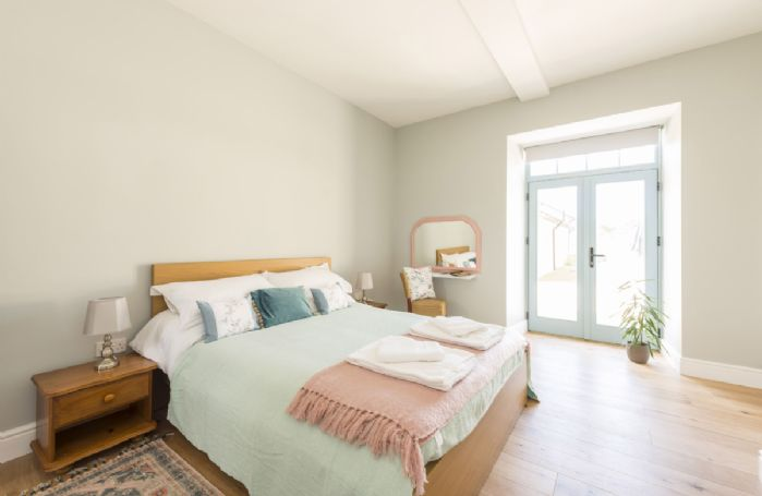 Ground floor:  Bedroom two with king-size bed and en-suite bathroom