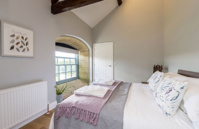 First floor:  Bedroom three with king-size bed and en-suite shower room