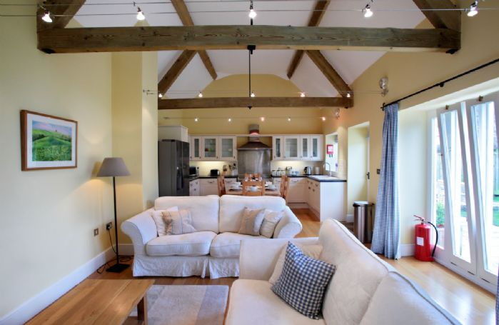 Ground floor:  Open-plan sitting room with dining area and kitchen