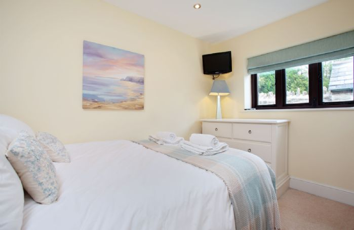 Ground floor:  Bedroom with double bed suitable for single occupancy