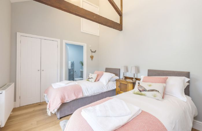 Drackenorth Lodge: First floor bedroom four with twin 2'6 beds and en-suite shower room
