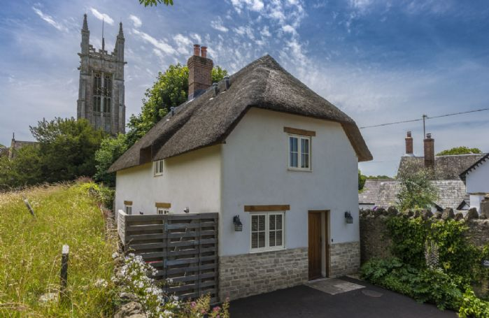 Church Cottage is an attractive, thatched cottage nestled proudly next to the church in this popular Dorset village