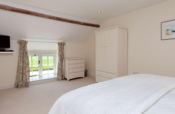 First floor: Bedroom three with super-king bed and en-suite bathroom
