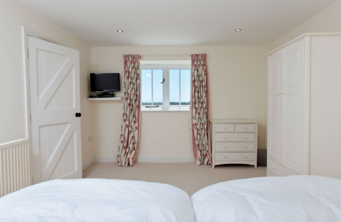 Upper ground floor: Bedroom two with twin single beds (can be configured as a super-king bed on request)
