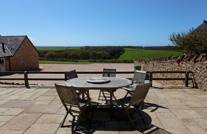 Garden furniture on the terrace with far reaching views