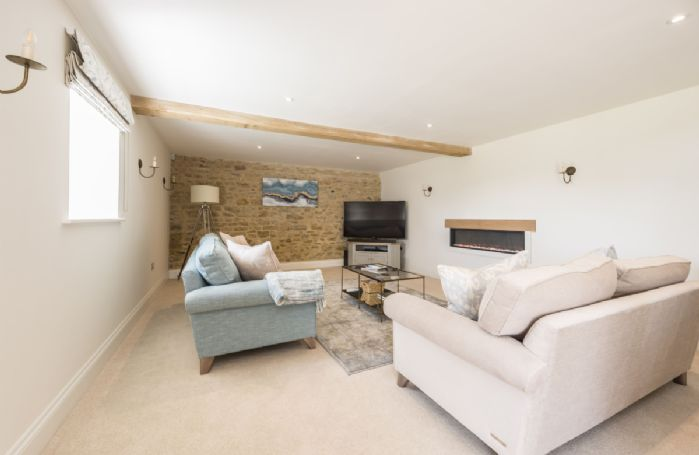 Ground floor: Sitting room with contemporary living flame electric fire