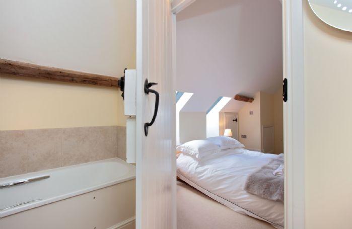 Mezzanine level:  En-suite bathroom with bath only