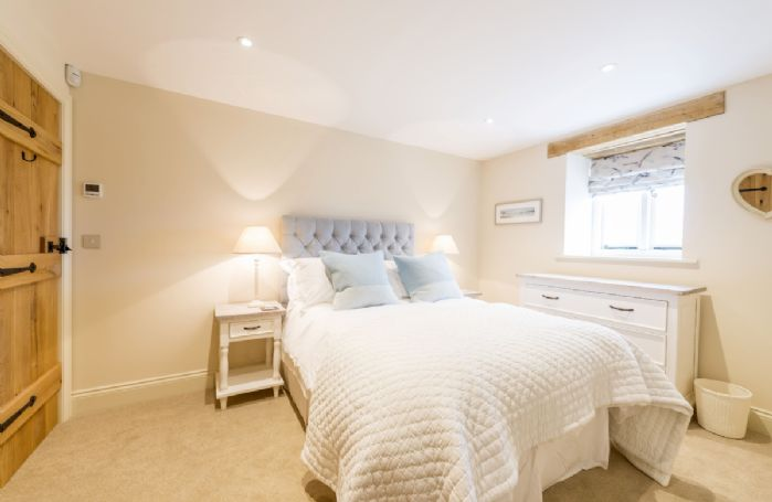 Ground floor: Bedroom two with double bed and en-suite shower room