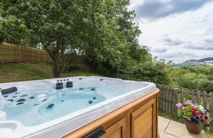 A privileged view of Golden Cap from the hot tub