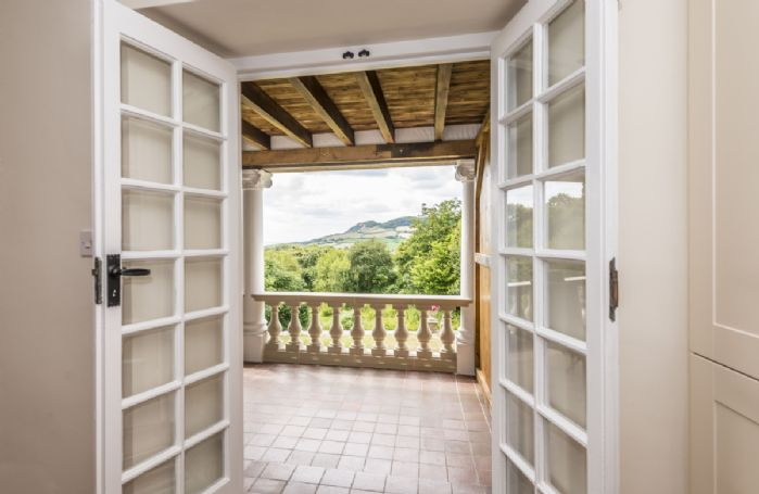 Doors from the kitchen and dining room to the large veranda with impressive views
