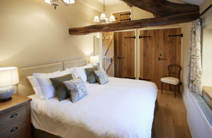 First floor: Bedroom 2 with 6' zip and link double bed and en-suite shower room