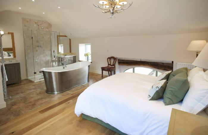 First floor: Bedroom 4 with 5' king size bed and integrated en-suite bathroom
